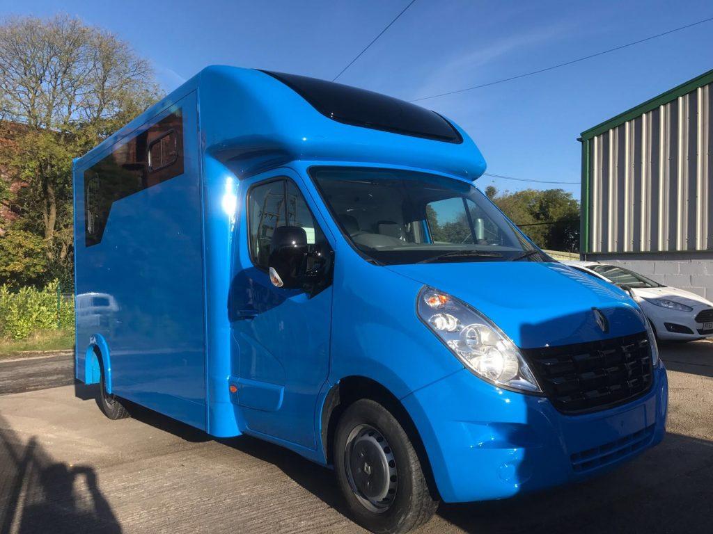 bright blue horse box cooper car amp commercial